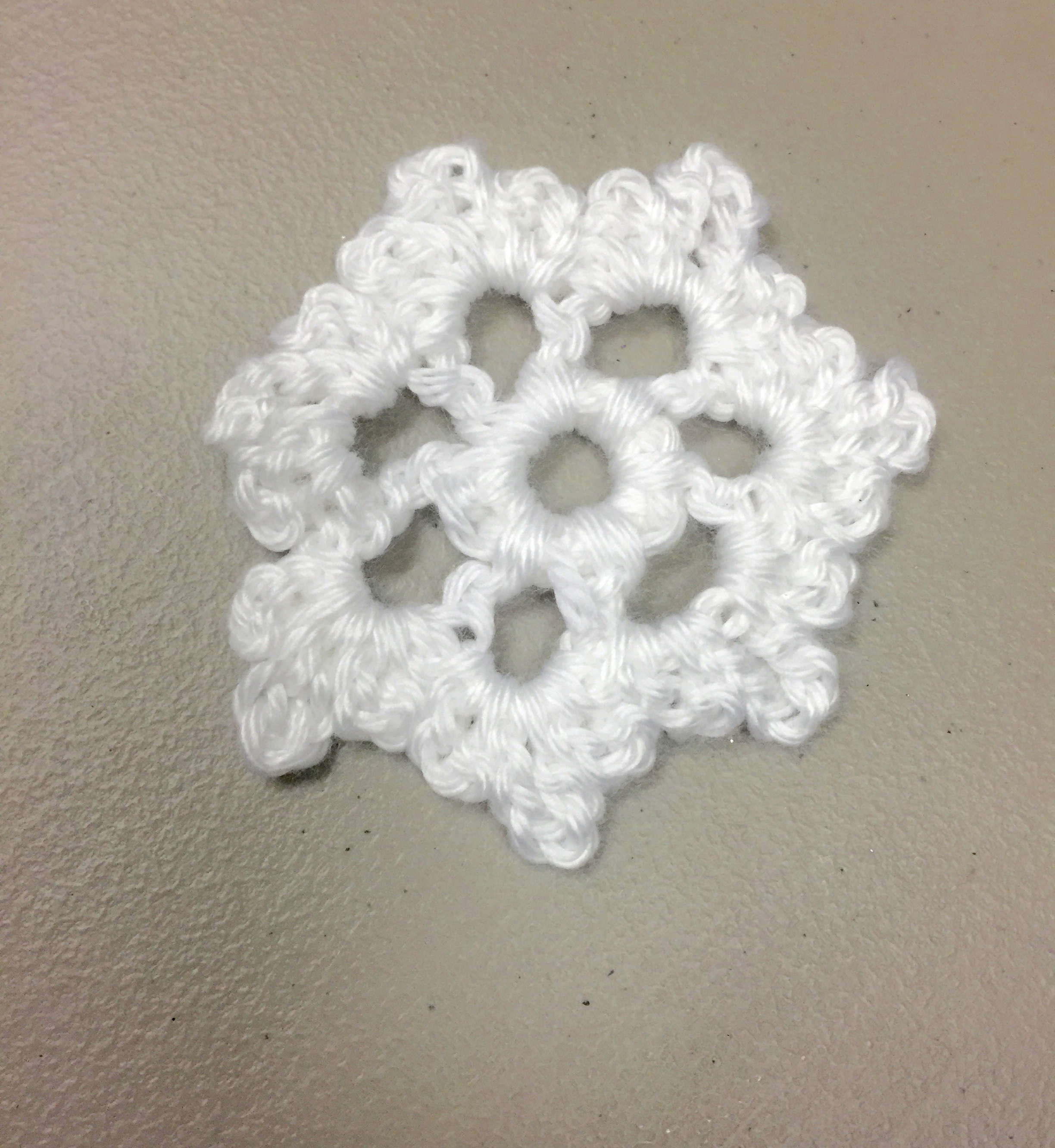 white crochet snowflake | The Magic Yarn Project